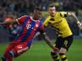 Bayern Jerome Boateng und Dortmund's Marco Reus (R) beim Bundesliga match Borussia Dortmund gegen FC Bayern München in Dortmundam 4.April 4 2015.  AFP PHOTO /  PATRIK STOLLARZ