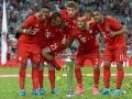 Bayern München gewinnt den Deutschen Supercup: David Alaba, Rafinha, Thomas Mueller, Arturo Vidal und  Douglas Costa am 5.August 2015.AFP PHOTO / CHRISTOF STACHE