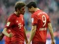 Robert Lewandowski und Thomas Müller erzielen jeweils 2 Tore gegen Dortmund beim heutigen Kklassiker am 4.Oktober 2015.  AFP PHOTO / CHRISTOF STACHE
