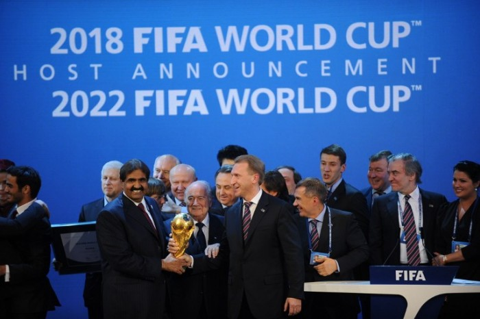 Emir of the State of Qatar Sheikh Hamad bin Khalifa Al-Thani (L), Fifa President Joseph Blatter (C) and Russia's Deputy Prime Minister Igor Shuvalov pose with the World Cup following the announcement that Russia and Qatar will host the 2018 and 2022 World Cups on December 2, 2010 at the FIFA headquarters in Zurich. AFP PHOTO / PHILIPPE DESMAZES