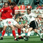 Thomas Haessler of Germany(R) tries to dribble past Russians Dmitri Khokhlov(L) and Vladislav Radimov (C) during the group C match Russia vs Germany at the European soccer Championships in Manchester 16 June. AFP PHOTO