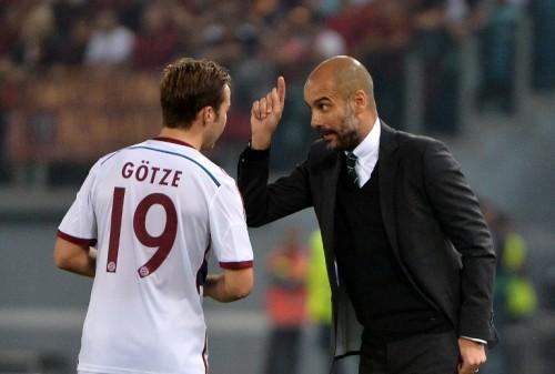 Mario Götze mit der 19 auf dem Bayern-Trikot. AFP PHOTO / ALBERTO PIZZOLI