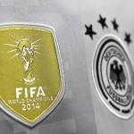 FIFA Badge und das DFB Logo auf dem neuen Deutschland Trikot 2016. AFP PHOTO / TOBIAS SCHWARZ