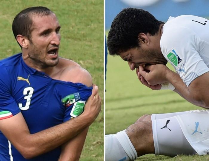 Italiens Giorgio Chiellini (L) und Luis Suarez (R) nach der Beissattacke bei der WM 2014. AFP PHOTO/ YASUYOSHI CHIBA / DANIEL GARCIA