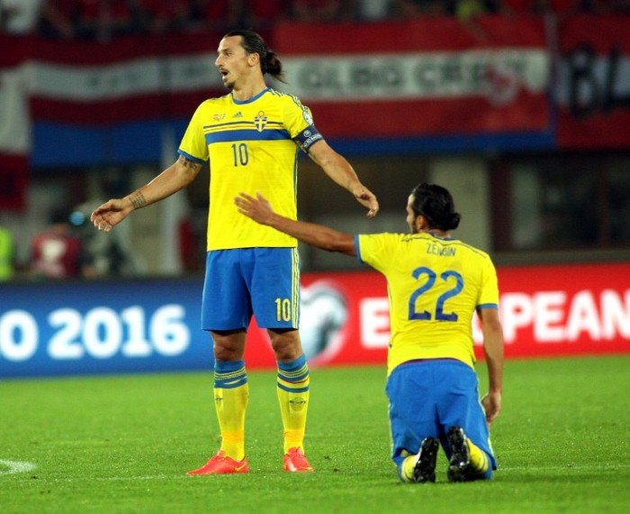 Sweden's forward Zlatan Ibrahimovic (L) and Sweden's midfielder Erkan Zengin react during the UEFA Euro 2016 Group G qualifying football match Austria vs Sweden on 8, 2014 in Vienna, Austria. The match ended with a 1-1 draw. AFP PHOTO / GUENTER R. ARTINGER