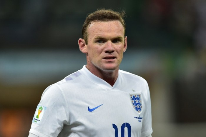 England's forward Wayne Rooney reacts during the Group D football match between Uruguay and England at the Corinthians Arena in Sao Paulo on June 19, 2014, during the 2014 FIFA World Cup. AFP PHOTO / NELSON ALMEIDA