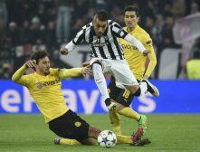 Fussball heute: Juventus Turin gegen BORUSSIA Dortmund: Roberto Pereyra (C) im Kampf mit Mats Hummels und Nuri Sahin (Foto AFP)