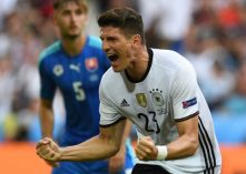 Germany's forward Mario Gomez celebrates after scoring a goal during the Euro 2016 round of 16 football match between Germany and Slovakia at the Pierre-Mauroy stadium in Villeneuve-d'Ascq near Lille on June 26, 2016. / AFP PHOTO / PATRIK STOLLARZ