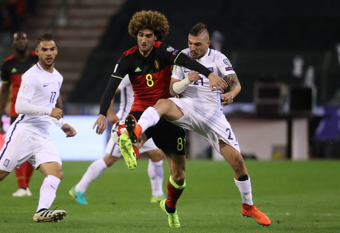 Belgiens Fellaini (L) gegen Griechenlands Stafylidis am 25.März 2017  / AFP PHOTO / Belga / VIRGINIE LEFOUR /